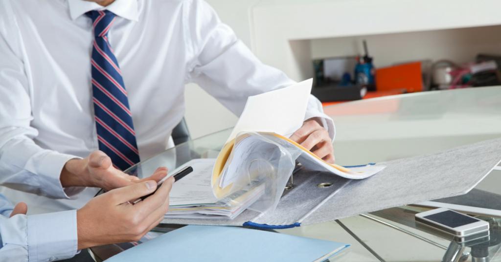 Behind paperwork